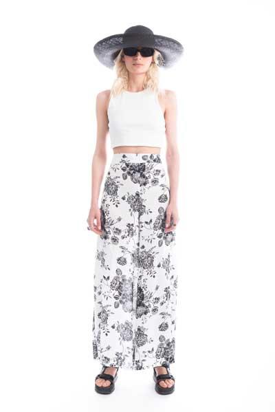 Δροσερή λευκή παντελόνα με μαυρο διακριτικό λουλούδι